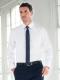 Camicia da divisa uomo elegante, maniche lunghe, modello slim fit, colore bianco, tessuto cotone poliestere, easy iron, pantaloni eleganti blu